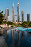 KLCC mirror from the lake. KLCC surrounded by the garde and near the lake Royalty Free Stock Images