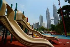 KLCC Park playground and Petronas Twin Towers. Kuala Lumpur. Malaysia Royalty Free Stock Image