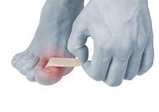 Klebender heilender Finger des Pflasters zu Fuß. Lizenzfreie Stockfotos
