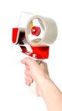 Klebstreifenhalter mit einem roten Stift Lizenzfreie Stockfotografie