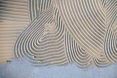 Kleefstof voor houten bevloering stock foto