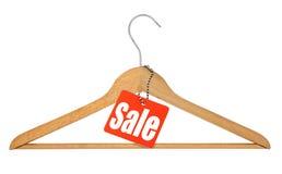 Kleerhanger en verkoopmarkering stock afbeelding