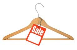 Kleerhanger en verkoopmarkering stock fotografie