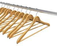 Kleerhangers op klerenspoor Stock Foto's