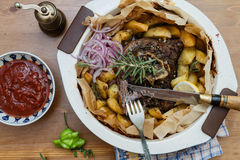 Kleftiko - slowly cooked lamb with vegetables and feta cheese. Greek dish. Stock Image