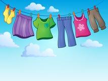 Kleidung auf Kleidungslinie Themabild 2 lizenzfreie abbildung