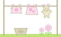 Kleidung des Mädchens auf einer waschenden Zeile Stockbilder