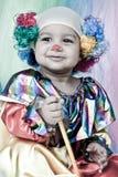 Kleidung eines tragende Clowns des netten Kindes. Stockfoto