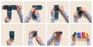 Kleidungs-Speicher Bestellung im Wandschrank Faltende Socken Vorlagen-Clas lizenzfreie stockfotografie