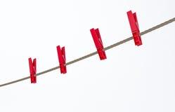 Kleidungstöpsel auf einer Zeile Lizenzfreie Stockfotografie