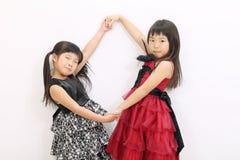 Klein Aziatisch meisje twee Stock Foto