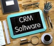 Klein Bord met CRM-Softwareconcept 3d Stock Foto's