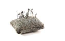 Klein kussen met naalden voor het naaien royalty-vrije stock afbeeldingen