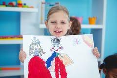 Klein meisje die een mooie tekening houden Stock Fotografie