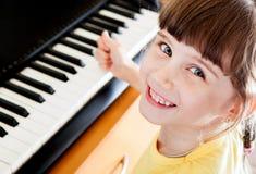 Klein Meisje met Piano Royalty-vrije Stock Foto's