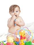 Klein mooi babymeisje in een engelen fansy kleding Stock Afbeeldingen