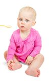 Klein Nice het meisje in roze kledingsvoer van lepel Stock Afbeelding