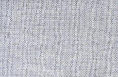 Klein patroon als achtergrond van grijs wol breiend garen Royalty-vrije Stock Fotografie