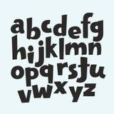 Kleinbuchstaben, Zahlen und Symbole des Alphabetes lokalisiert auf schwarzem Hintergrund Lizenzfreie Stockbilder