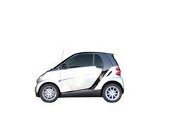 Kleine auto op wit met het knippen van weg Stock Afbeelding