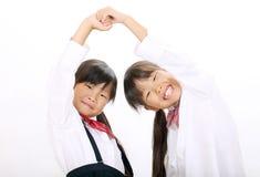 Kleine Aziatische schoolmeisjes Royalty-vrije Stock Afbeeldingen
