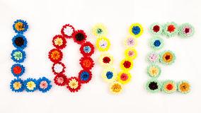 Kleine, bunte Papierblumen Stockfotos