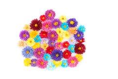 Kleine, bunte Papierblumen gemacht mit Rüschentechnik Lizenzfreies Stockfoto