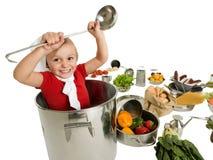 Kleine chef-kok in grote pot Stock Afbeelding