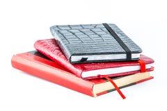 Kleine dagboeken op witte achtergrond Stock Fotografie