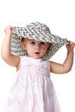 Kleine Dame in einer großen Mütze Stockbilder