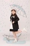 Kleine Dame mit Regenschirm Lizenzfreies Stockbild