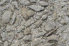 Kleine der Straße ganz graue und große Steine Lizenzfreie Stockfotos