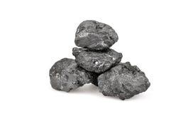 Kleine die stapel van steenkool op wit wordt geïsoleerdd Royalty-vrije Stock Foto's