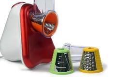 Kleine elektrische huishoudapparaten voor het verkrachten en het snijden veget Stock Foto