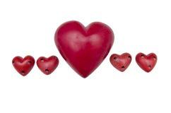 Kleine en grote rode hartstenen Stock Foto