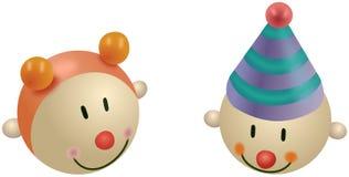Kleine farbige Spielwaren des Mädchens und des Clowns Lizenzfreie Stockfotografie