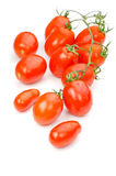 Kleine geïsoleerde tomaten, Stock Afbeeldingen