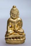 Kleine goldene Statue von Buddha Lizenzfreie Stockfotos