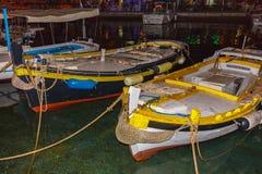 Kleine hölzerne Fischerboote im Marinesoldaten Stockbilder