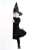 Kleine Hexe mit Fahne Stockbild