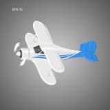 Kleine Illustration des flachen Vektors Einmotorige angetriebene Doppeldeckerflugzeuge Auch im corel abgehobenen Betrag Stockfoto