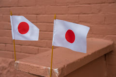 2 kleine Japanse vlaggen Stock Afbeeldingen
