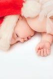 Kleine jongensslaap in GLB van een Nieuwjaar Stock Foto's