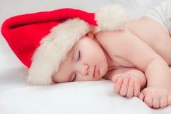 Kleine jongensslaap in GLB van een Nieuwjaar royalty-vrije stock foto's