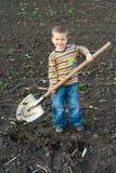 Kleine kinderen met grote schop Royalty-vrije Stock Foto