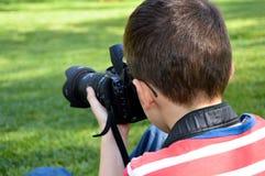Kleine kindfotograaf Stock Foto