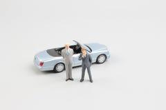 Kleine Kleinbetriebzahl mit Auto Stockbild