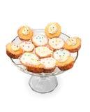 Kleine Kuchen auf einer Glasplatte Stockfotografie