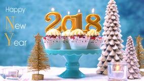 Kleine Kuchen des guten Rutsch ins Neue Jahr 2018 Lizenzfreie Stockbilder