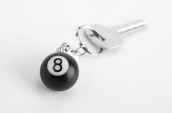 Kleine Kugel 8 auf Schlüsselring Stockfoto